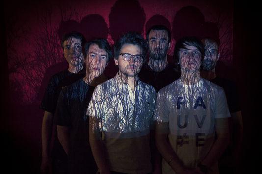 Les membres du collectif, visages dévoilés. Crédit photo : Samuel Kirszenbaum/Le Monde.