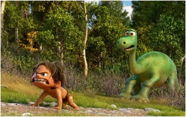 Dans le monde imaginé par Pixar, l'espèce intelligente est celle des dinosaures, qui travaillent pour vivre. Spot, l'enfant sauvage est plus proche d'un animal que d'un être humain. (Crédit photo : Pixar)
